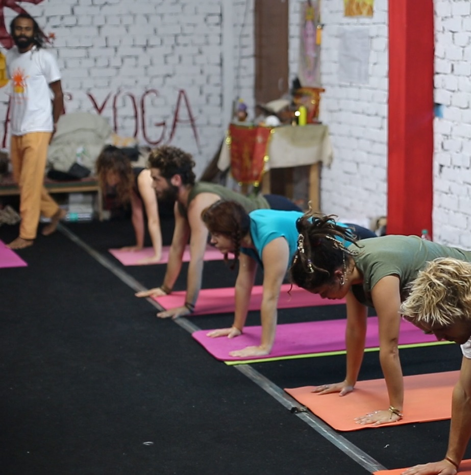 Teacher inspecting yoga positions at shree hari yoga school 'drop in classes'