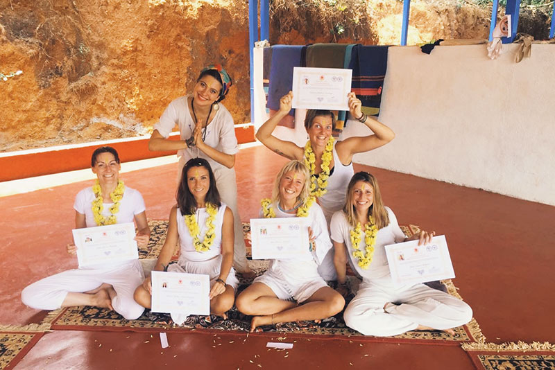 200 hour ryt celebrate their certificates and are very happy