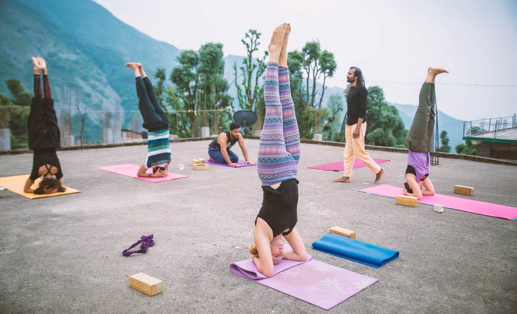 headstand in 500 hour yoga instructor course, dharamshala, himalaya, india