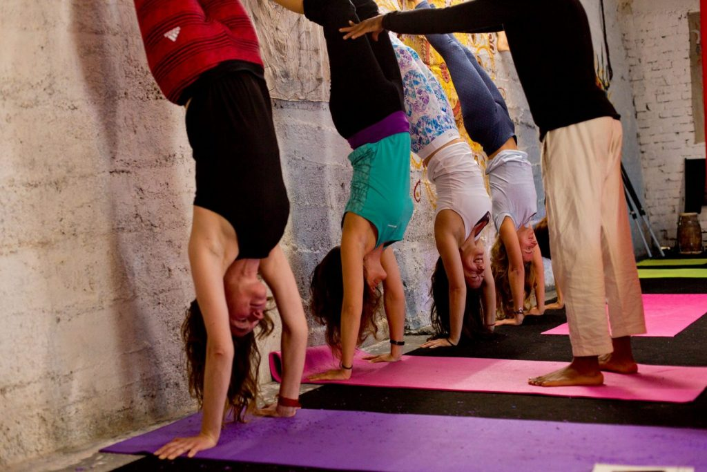 Handstand with wall support shree hari yoga, dharamshala, india