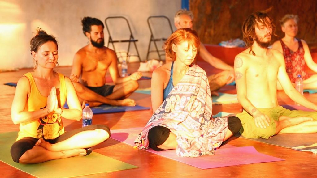 spiritual meditation at shree hari yoga school and center at the ocean beach site in india
