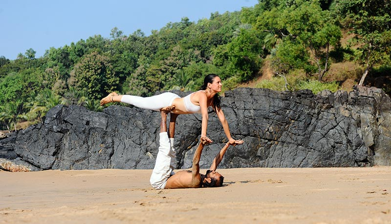 acrobatic yoga at the beach for couples and singles at shree hari yoga school