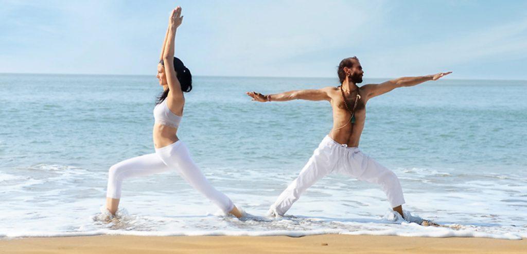 strenghtening of leg muscles with warrior asana posture, yoga at the beach, shree hari yoga center