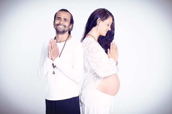 photo of pregnancy yoga couple