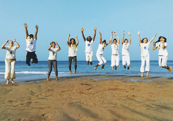 yoga teacher training at the beach ends with a jumping group of people from shree hari yoga school