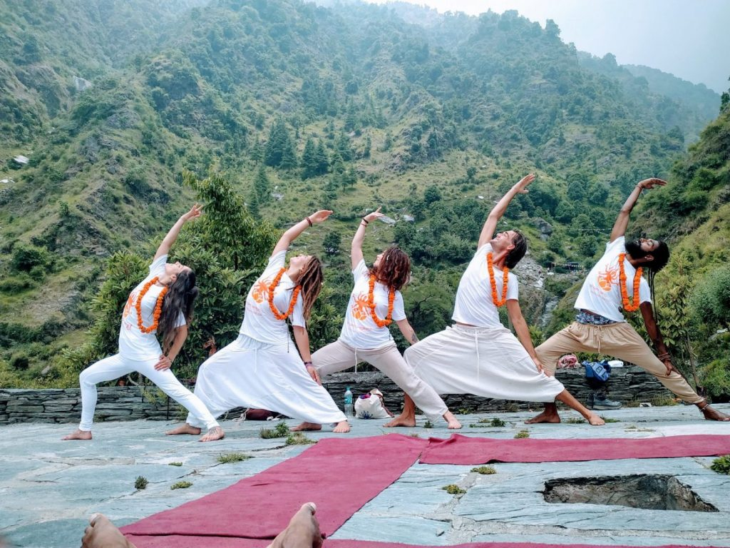 warrior posing in the himalayas from shree hari yoga students in rishikesh