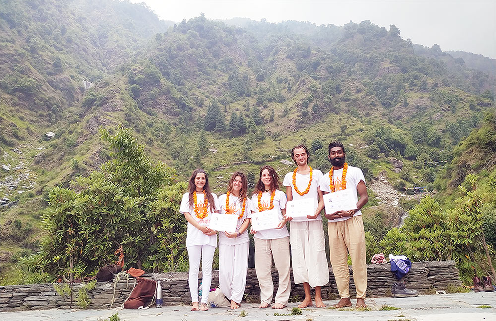 students celebrate their yttc in rishikesh in the holy mountains of the himalaya