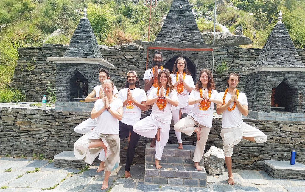 namaste pose of yttc students of shree hari yoga school ashram in rishikesh